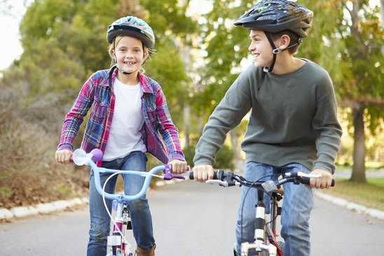 Two Children On Cycle Ride In Countryside